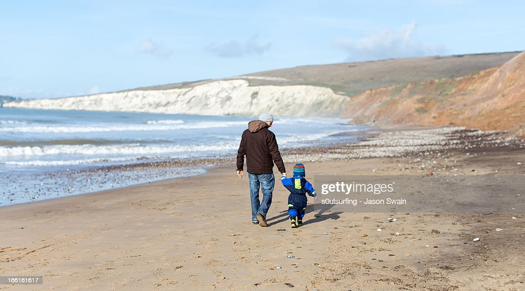 Winter Beach Walk with Dad : Stock Photo