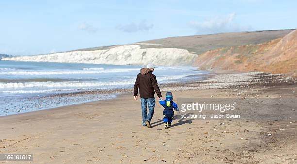 winter beach walk with dad - compton bay isle of wight stock pictures, royalty-free photos & images