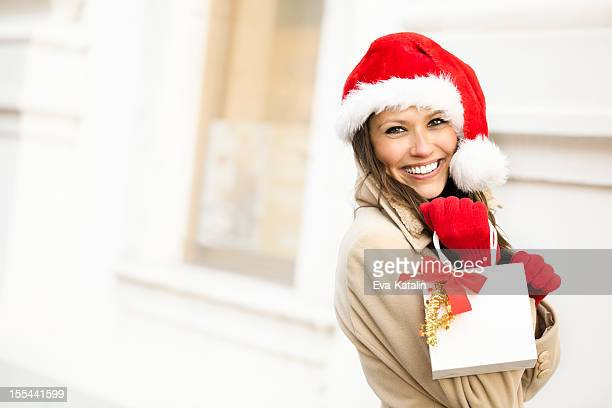 winter beauty holding a christmas present - black friday stock pictures, royalty-free photos & images