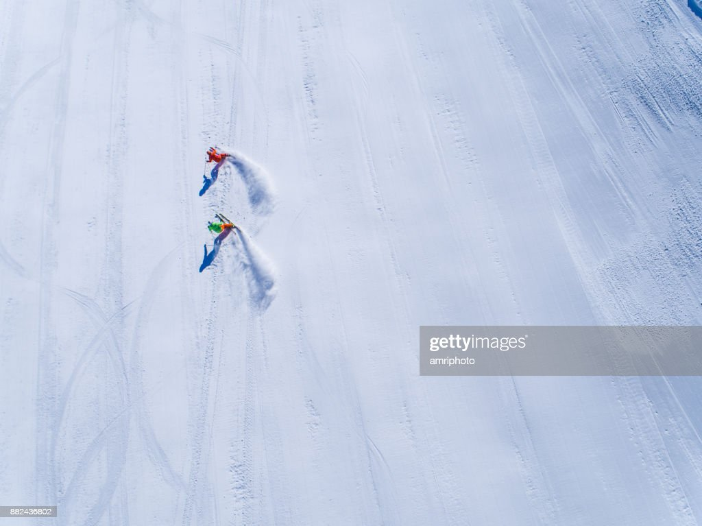 Winter Breaks - aerial view two skiers skiing : Stock Photo