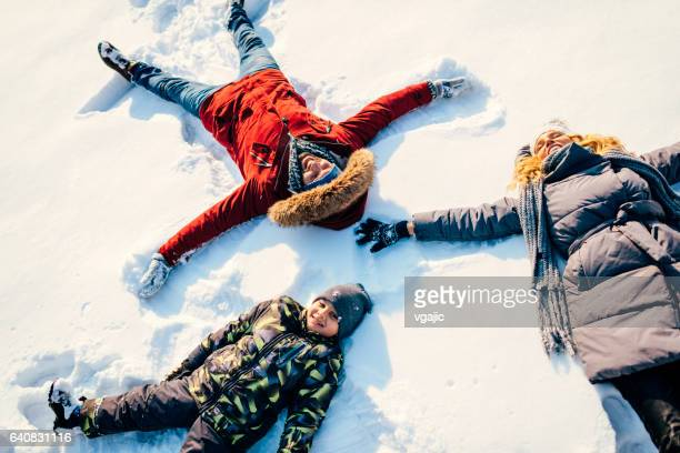 winter breaks - snow angel stock photos and pictures
