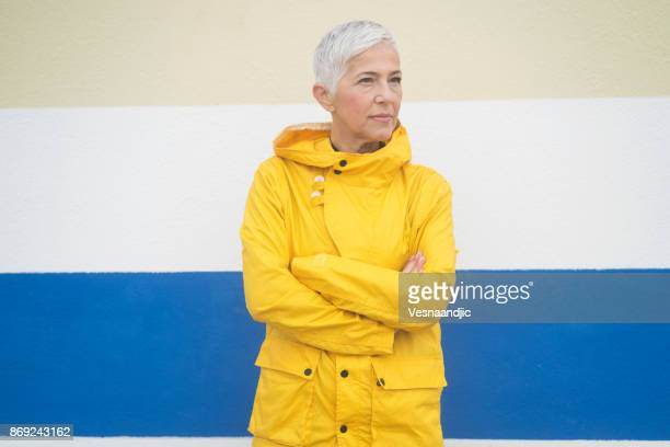 winter breaks - raincoat stock photos and pictures
