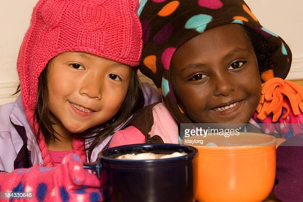 winter buddies drinking cocoa - mitten stock pictures, royalty-free photos & images