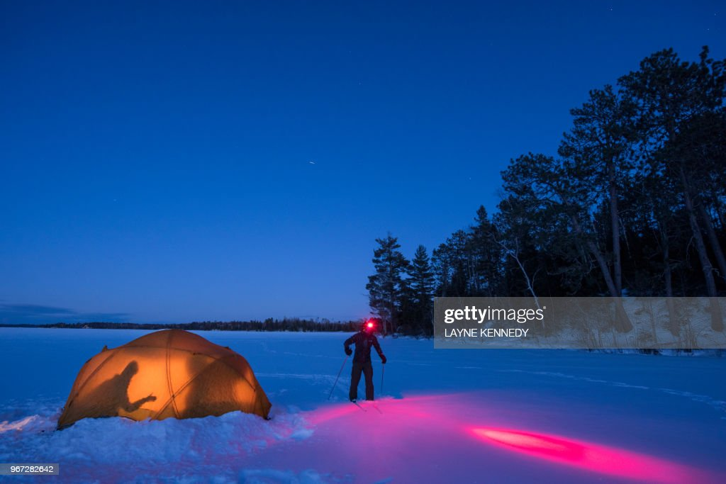 Winter camping on frozen lake in Minnesota's Superior National Forest.
