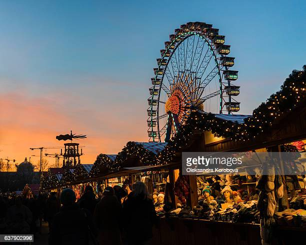 Winter carnival sunset with an ornate ferris wheel.