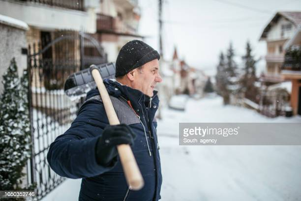 winter chores - snow shovel stock photos and pictures