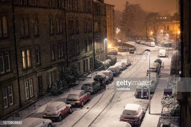 winter city street in the night under the snow in uk - texas stock pictures, royalty-free photos & images