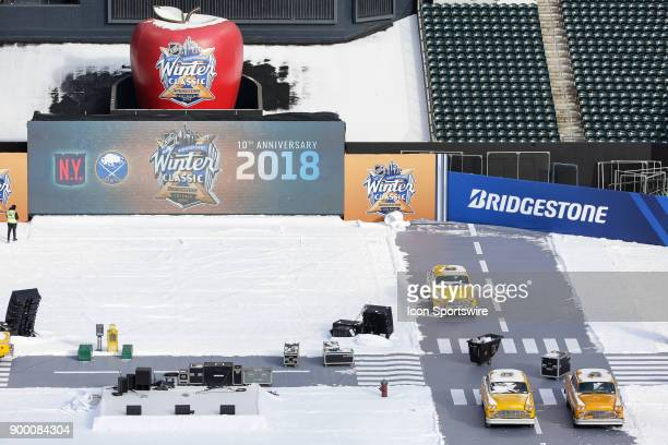 Winter Classic signage and taxi cabs are displayed rink side during practice for the the New York Rangers and Buffalo Sabres Winter Classic NHL game...