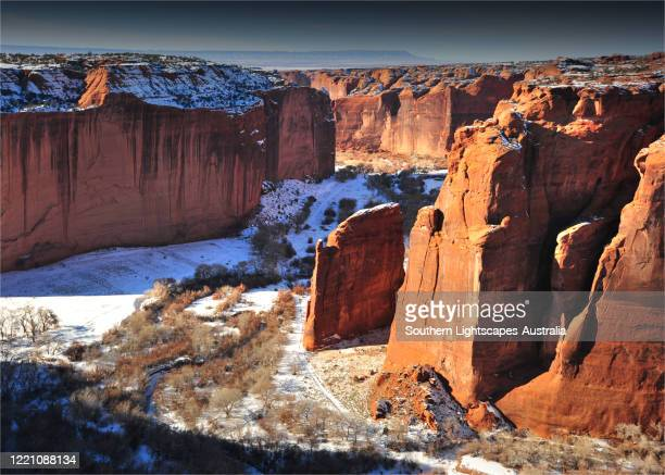 a winter coating of fresh snow covers the landscape at canyon de chelly national monument, in northeastern arizone, usa. - canyon de chelly national monument stock pictures, royalty-free photos & images