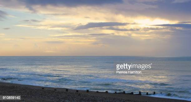 winter colours on the beach - english channel stock photos and pictures