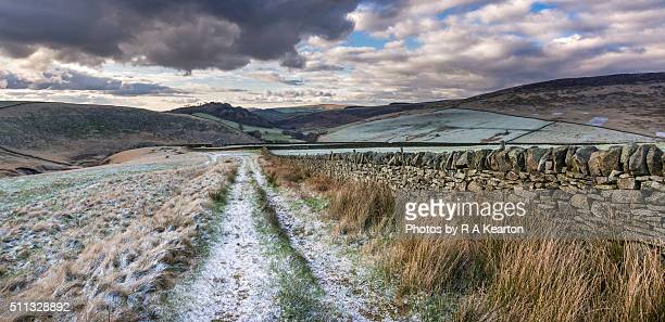 winter colours on the hills near glossop, derbyshire. - stone wall stock pictures, royalty-free photos & images