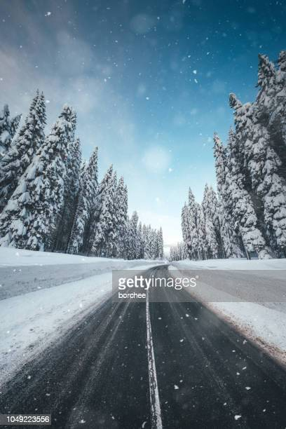 winter conditions - driving in snow stock photos and pictures