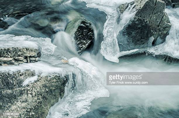 winter convergence: water/ice/rocks - sursly stock pictures, royalty-free photos & images