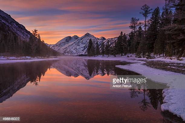 Winter dawn on the river in the mountains