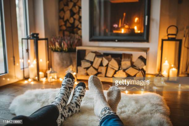 winter day by fireplace - camino foto e immagini stock