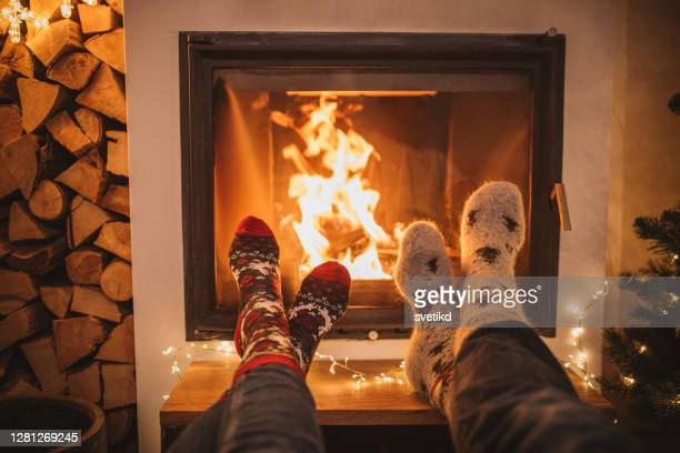 winter day by fireplace - burning stock pictures, royalty-free photos & images