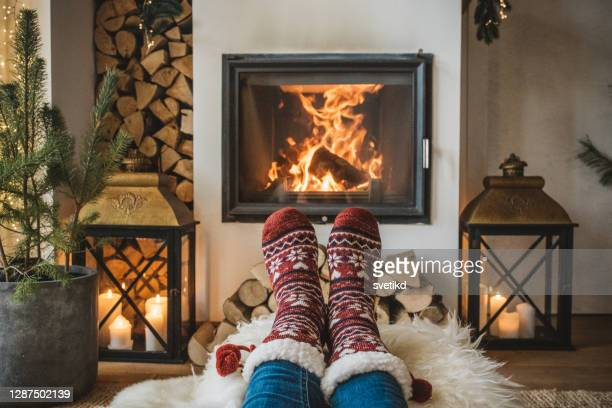 winter day by fireplace - cosy stock pictures, royalty-free photos & images
