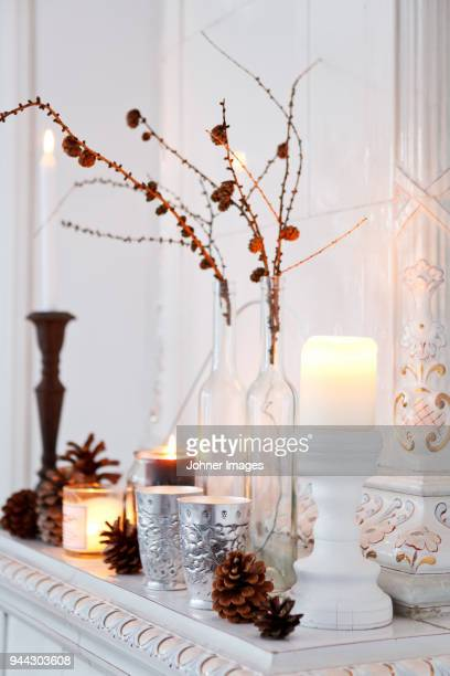 winter decorations with candles - candle stock pictures, royalty-free photos & images