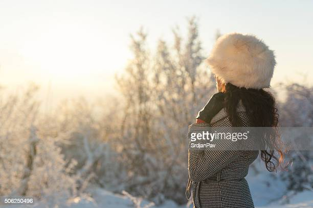winter escape - fur hat stock photos and pictures