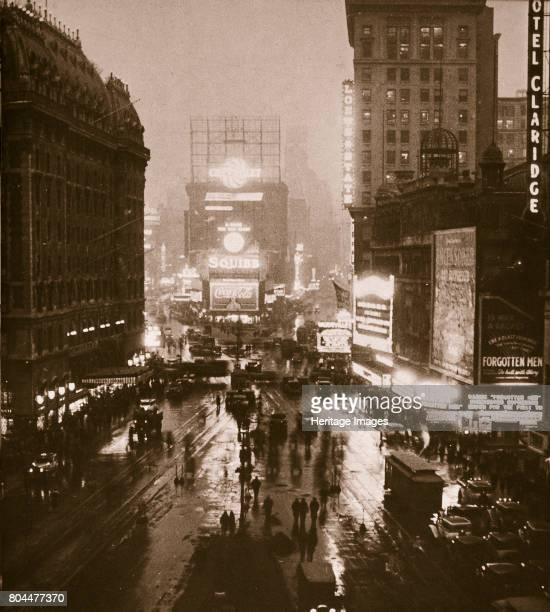 Winter evening on Times Square and Broadway New York USA early 1930s View showing cinemas and theatres