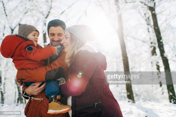 winter family portrait - winter family stock photos and pictures