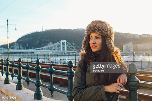 Winter fashion portrait of a young woman in the city