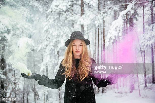 Winter fashion portrait with smoke fountains