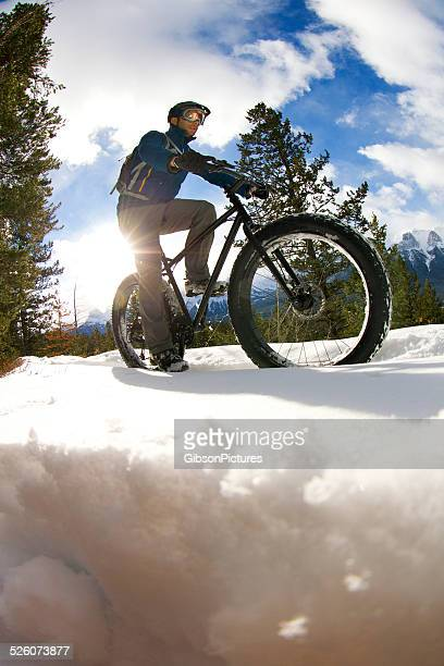 winter fat bike rider - cross country cycling stock photos and pictures
