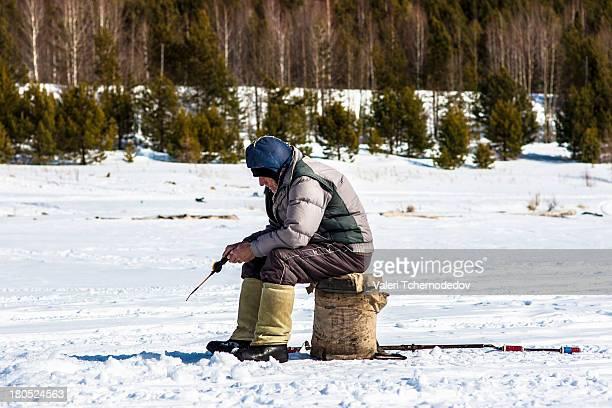 Winter fishing on frozen Angara river
