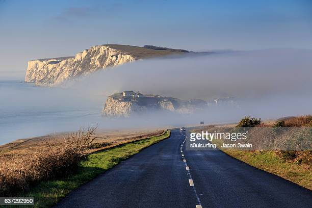 winter fog at freshwater bay on an otherwise sunny day - isle of wight stock pictures, royalty-free photos & images