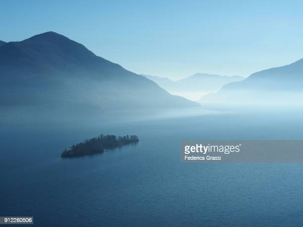 winter fog hovering over the brissago islands and lake maggiore - ascona stock photos and pictures
