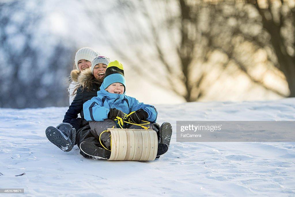 Winter Fun on Tobbogan Hill : Stock Photo