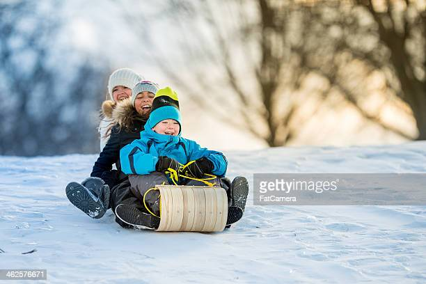 winter fun on tobbogan hill - recreational pursuit stock pictures, royalty-free photos & images