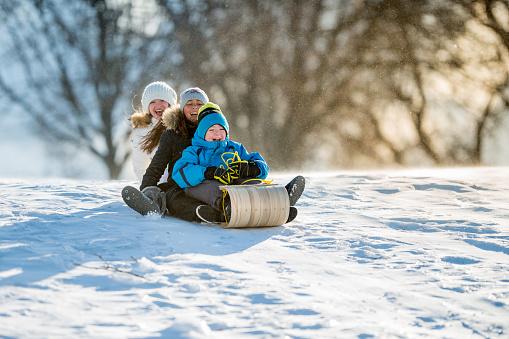 Winter Fun on Tobbogan Hill 472099921