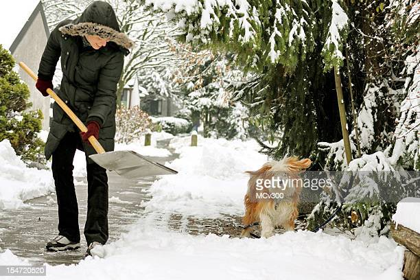 winter fun - snow shovel stock photos and pictures
