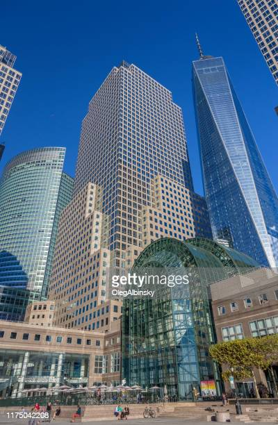 winter garden atrium at brookfield place with world trade center tower and high-rises of world financial center, manhattan lower west side, ny, usa - world financial center new york city stock pictures, royalty-free photos & images