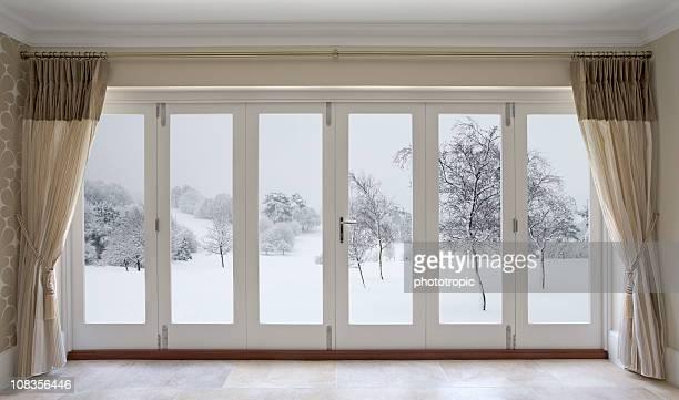 winter garden view - patio doors stock pictures, royalty-free photos & images