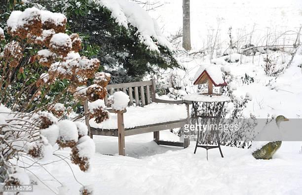 Winter garden with bench, bird feeder,side table ,stone goose