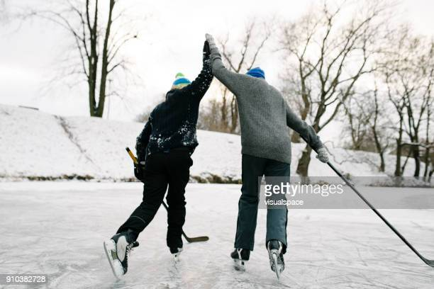 winter hockey celebration - winter sport stock pictures, royalty-free photos & images