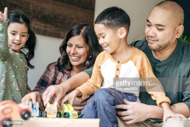 winter holidays with children - family at home stock photos and pictures