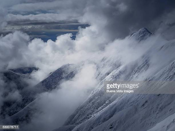 Winter in a mountain among clouds