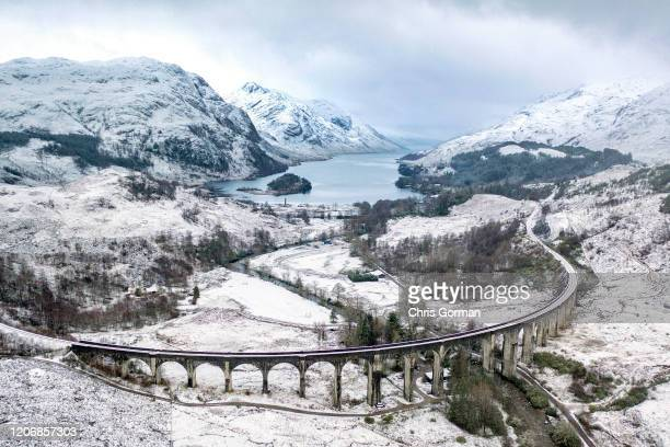 Winter in all its majesty at Glenfinnan Viaduct in the Scottish Highlands on January 29, 2020 in Glenfinnan, Scotland. The viaduct is well know to...