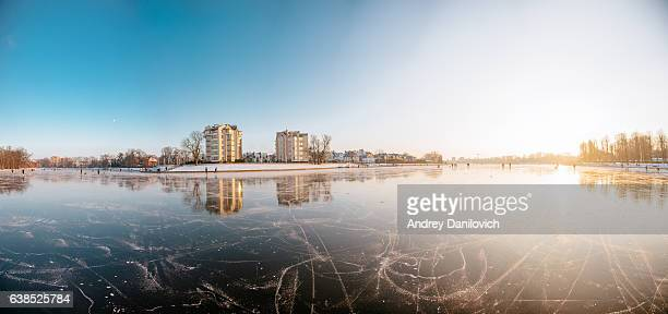 Winter in Kaliningrad, Russia. People ice skating on the lake