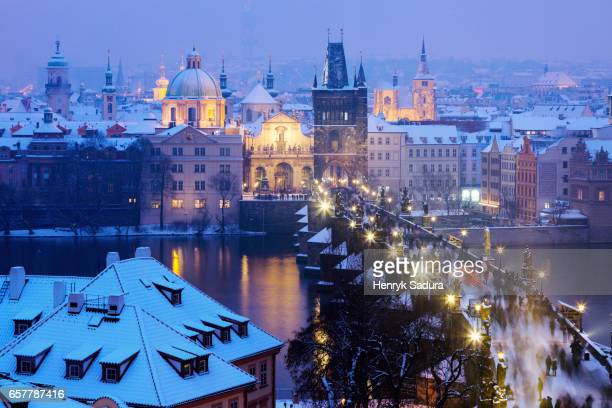 Winter in Prague - city panorama with Charles Bridge