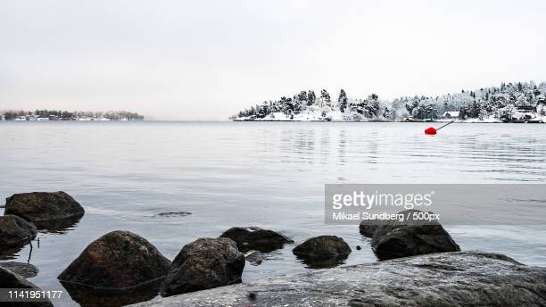 winter in stockholm - riverbank stock pictures, royalty-free photos & images