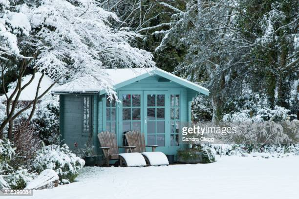 Winter in the garden in the snow with the Summer house