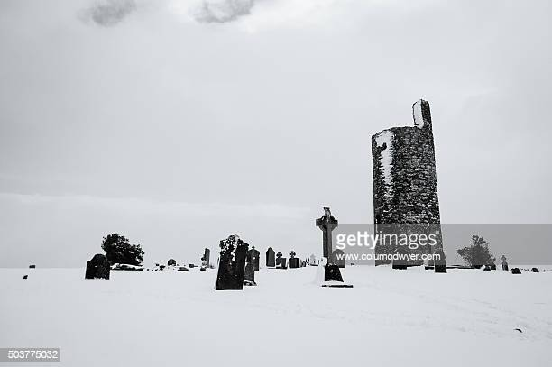 winter in the graveyard - kildare stock photos and pictures