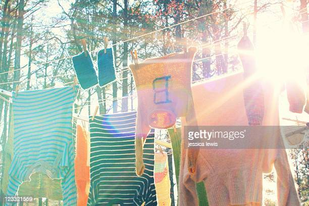 Winter knits hanging on clothes line in spring