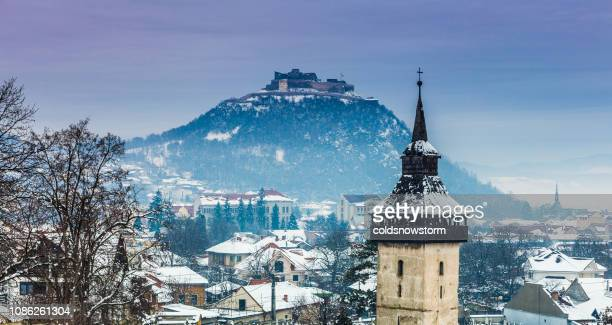 winter landscape and church spire in transylvania, romania - transylvania stock pictures, royalty-free photos & images