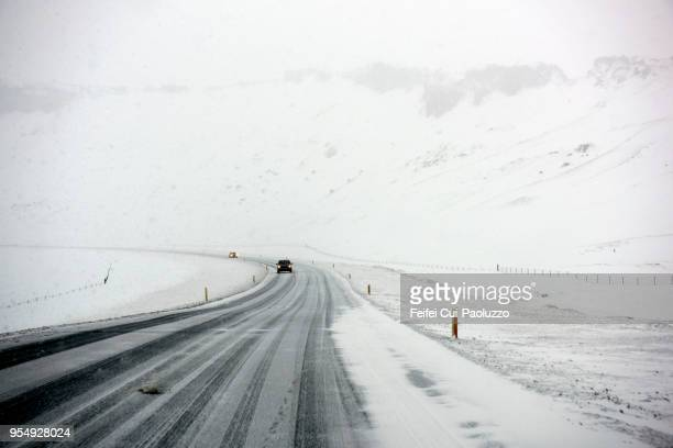 Winter landscape and snowing road Near Vik, South Iceland